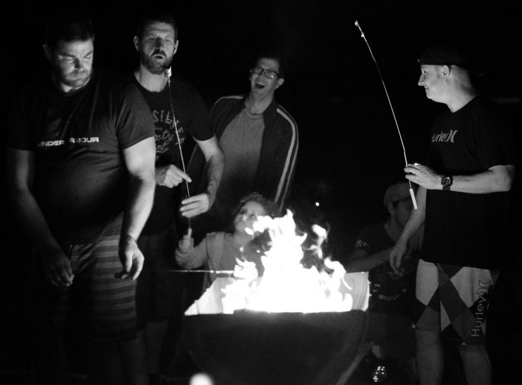 Dads of Kensington Primary School having fun and chatters around the campfire