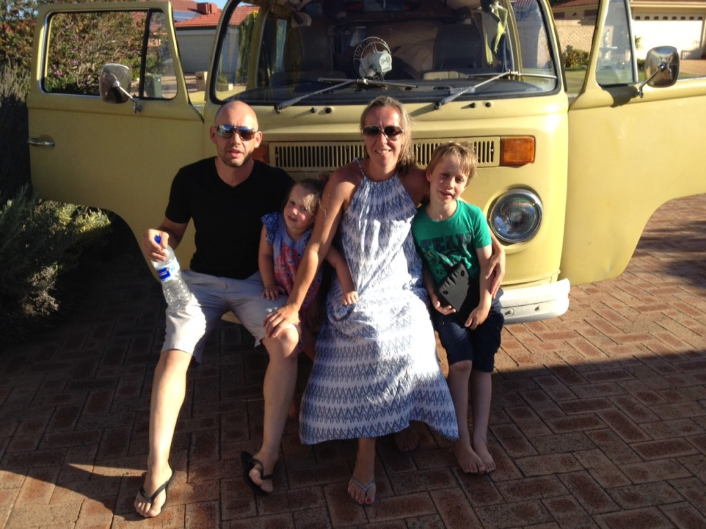 Family holidays: Justine Peel and family taking a photo in front of a kombi van